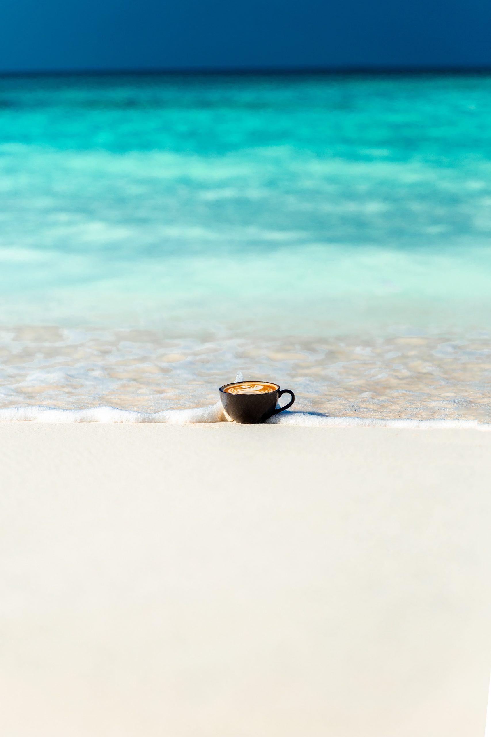 black ceramic cup in sea